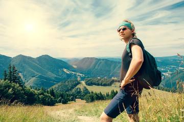 Young man traveler in mountain
