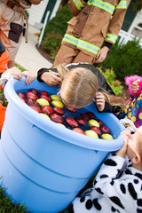 Halloween: Girl Bobbing For Apples