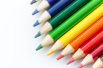Colored pencils angled on a white background.