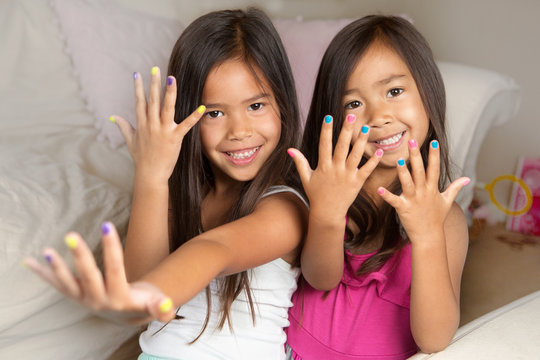 Little girls with painted nails.