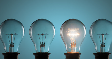 Idea concept. Light bulbs on blue background