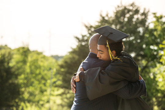 African American father and son at graduation.