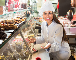 Shopgirl with chocolate and confectionery .