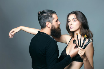 visagiste bearded man and sexy woman