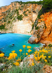 Greek hidden beach in Zakynthos with iconic blue waters and summ