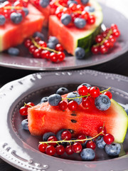 Slice of watermelon with fresh berries