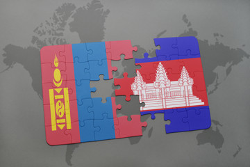puzzle with the national flag of mongolia and cambodia on a world map background.