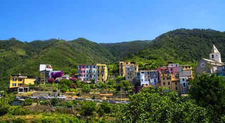 View of colorful village Corniglia, Cinque Terre region, La Spezia, Italy. Vineyards and houses.