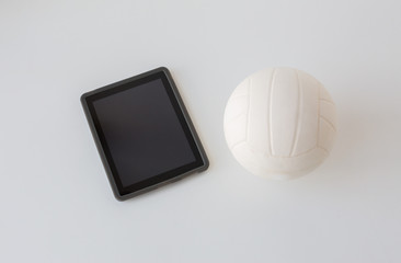 close up of volleyball ball and tablet pc computer