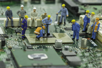 engineers are fixing chip-set on green mainboard