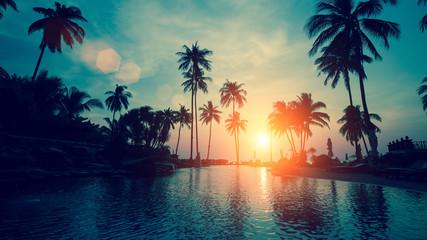 Fantastic sunset at a beach resort in tropics.
