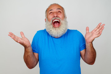 Fit aged bearded man overwhelmed with positive emotions