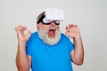 Freaked out bearded man in 3D virtual reality glasses