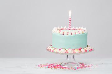 Pastel Blue Birthday Cake over White Background.