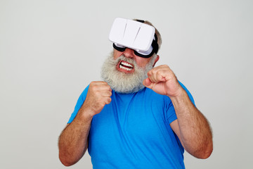 Man in VR-headset standing in fighting pose with clenched fists