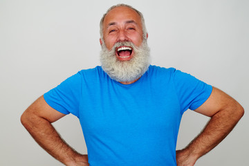 Portrait of laughing good-looking aged man with white beard
