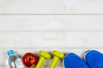 View of concept of fitness and dieting plan on white wood background