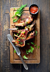 grilled ribs on a cutting board. rustic style