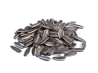 sunflower seeds pile against white background