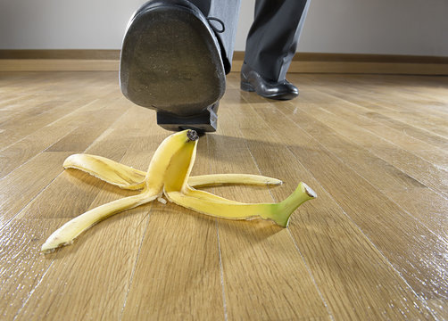 Man about to step on banana peel close up.