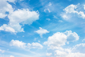 Puffy clouds on fresh cheerful blue sky