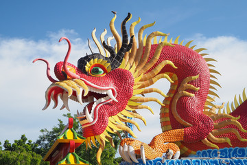 Red big dragon statue in public place of worship