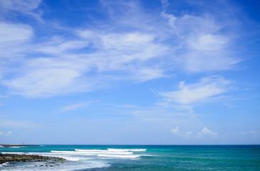 seashore view with rocks, waves