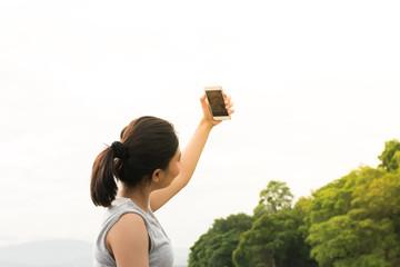 Pregnant woman making self portrait