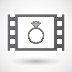Isolated 35mm film frame with an engagement ring