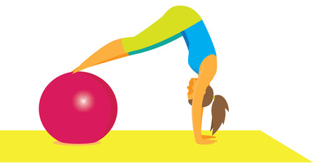 young woman is engaged with gymnastic ball