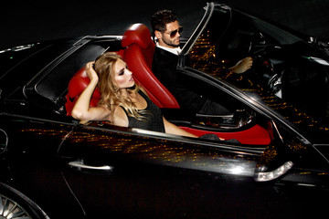 Couple in luxury car.