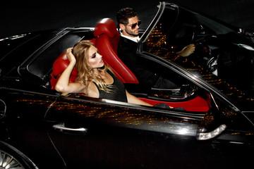 Couple in luxury car.