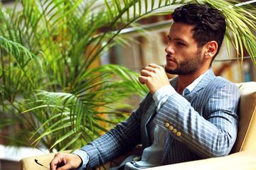 Portrait of an handsome businessman relaxing in garden