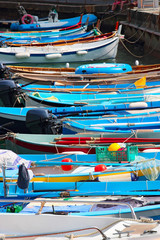 Bright blue boats in the port, Cinque Terre, Liguria province, Italy.