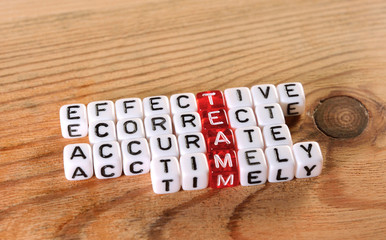 Team acronym on dices