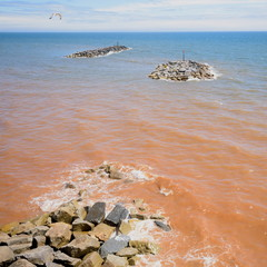 Beach during low tide in Sidmouth, Devon is part of Jurassic Coast which was awarded World Heritage Site status in December 2001