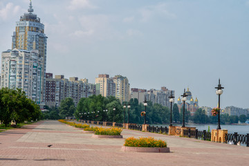 Kiev. Broad Quay Summer with flower beds in the area Obolon along the Dnieper River