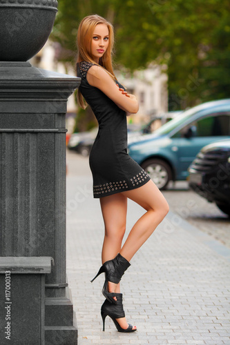 666ec1db283 Beautiful sexy woman with black dress and blond hair posing outdoor ...