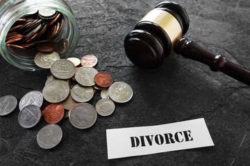 Divorce message with coins and gavel