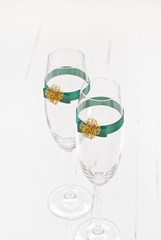 Two elegant champagne glasses with decoration ribbon.White background.Shallow depth of field