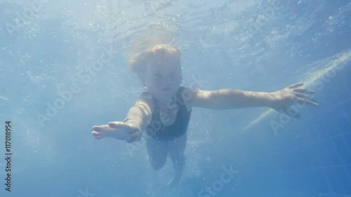 Happy smiling underwater child in swimming pool - Swimming pool girl christmas vacation ...
