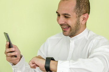 man in shirt uses a smart watch