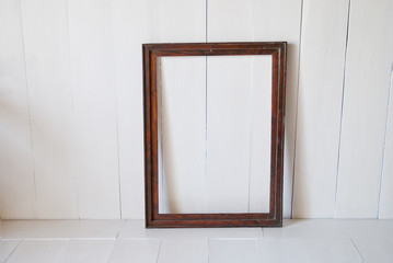 Frame picture in the empty room from wooden board wall and wooden floor.