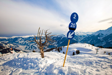 Blue route sign on the ski resort
