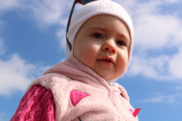 Outdoor portrait young child on a background of blue sky