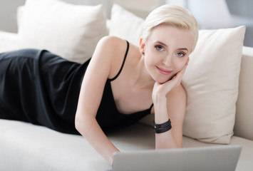 Woman with laptop looking at camera