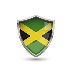 National flag of Jamaica. Flag on the metal shield with glare.