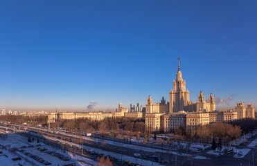 Wide angle view of main building of morning Moscow State University in sunny winter