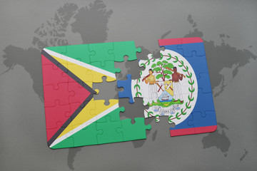 puzzle with the national flag of guyana and belize on a world map background.