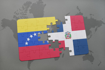puzzle with the national flag of venezuela and dominican republic on a world map background.
